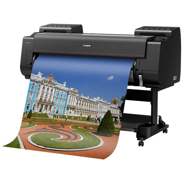 Canon ImagePrograf Pro-4100 printing a city view with paper outputting from printer.
